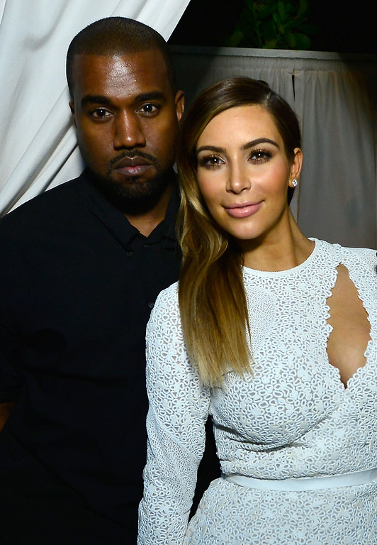 . Kanye West (L) and Kim Kardashian attend DuJour Magazine\'s event to honor artist Marc Quinn at Delano Beach Club on December 4, 2013 in Miami Beach, Florida.  (Photo by Eugene Gologursky/Getty Images for DuJour Magazine)