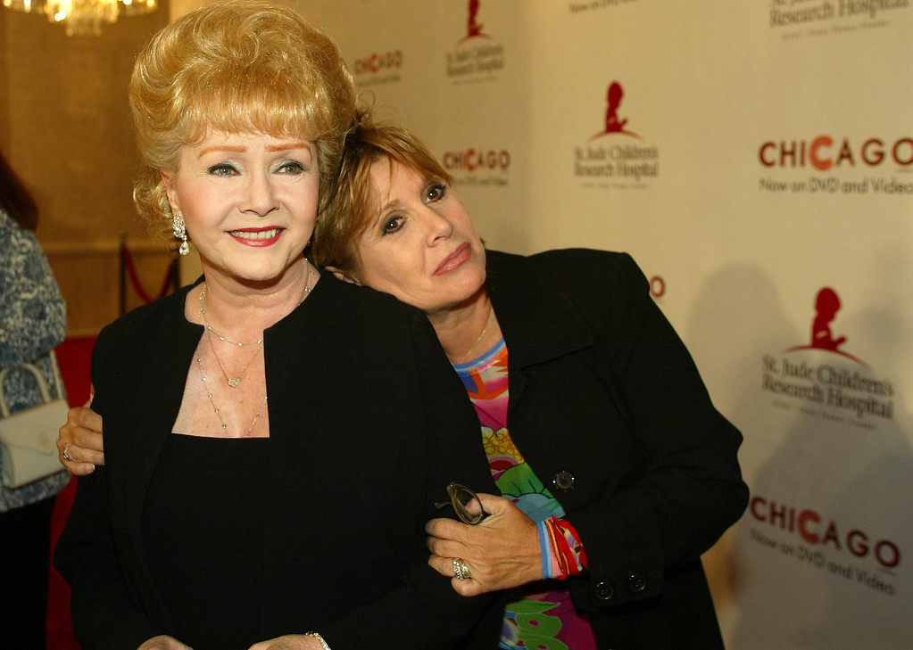 """. Debbie Reynolds and Carrie Fisher arrive at the \""""Runway for Life\"""" Celebrity Fashion Show Benefitting St. Jude\'s Children\'s Research Hospital and celebrating the DVD relese of Chicago in Beverly Hills, Calif., Tuesday, Aug. 19, 2003. (AP Photo/Jill Connelly)"""