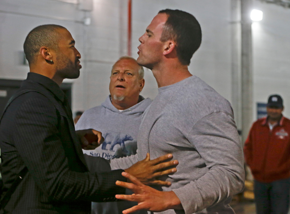 . Los Angeles Dodgers\' Matt Kemp, left, is stopped by San Diego Padres\' Clayton Richard when Kemp confronted the Padres\' Carlos Quentin in the tunnel walk-way exiting Petco Park following the  baseball game between the Los Angeles Dodgers and San Diego Padres in which a brawl occurred when Quentin was hit by a pitch from the Dodgers\' Zack Greinke in San Diego, Thursday, April 11, 2013. Greinke suffered a broken left collarbone in the brawl.   (AP Photo/Lenny Ignelzi)