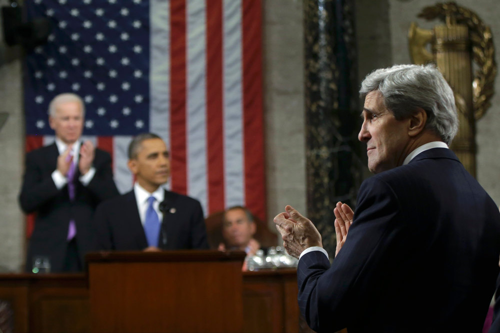 Description of . U.S. Secretary of State John Kerry (R) stands to applaud as President Barack Obama delivers his State of the Union speech on Capitol Hill in Washington, February 12, 2013. REUTERS/Charles Dharapak/Pool