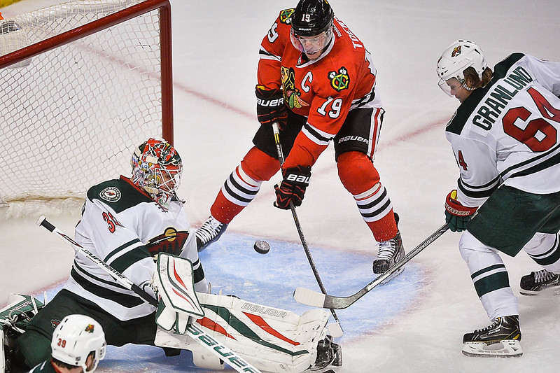 . Chicago Blackhawks center Jonathan Toews nearly scores on Minnesota Wild goalie Ilya Bryzgalov during the third period. At right is Minnesota Wild center Mikael Granlund. (Pioneer Press: Ben Garvin)