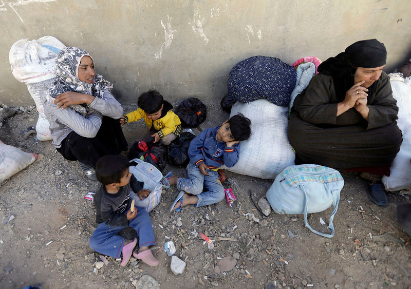 . A Syrian family who fled to Lebanon this morning from the own of Qusair after it fell in the hands of Syrian forces loyal to President Bashar Assad and Hezbollah fighters, waits to move to the home of their relatives in Arsal town, near the Lebanese-Syrian border, Wednesday, June 5, 2013. The Syrian army captured a strategic town near the Lebanese border on Wednesday after a grueling three-week battle, handing a heavy defeat to rebels and solidifying a shift in the country\'s civil war in favor of President Bashar Assad\'s regime.(AP Photo/Hussein Malla)