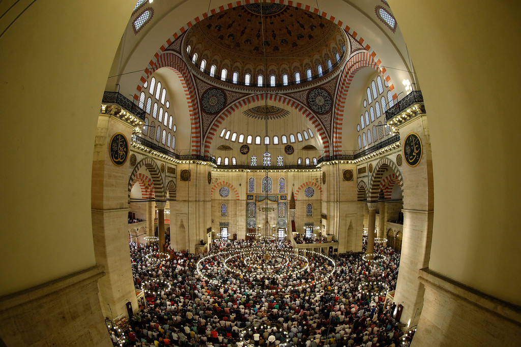. Turkey\'s Muslims offer prayers during the first day of Eid al-Fitr, which marks the end of the holy fasting month of Ramadan at the the Suleymaniye Mosque in Istanbul, early Friday, June 15, 2018. (AP Photo/Emrah Gurel)