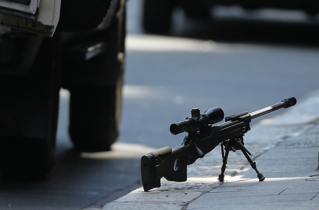 . SYDNEY, AUSTRALIA - DECEMBER 15:  A snipers rifle is seen on the ground in Phillip St on December 15, 2014 in Sydney, Australia.  Police attend a hostage situation at Lindt Cafe in Martin Place.  (Photo by Mark Metcalfe/Getty Images)