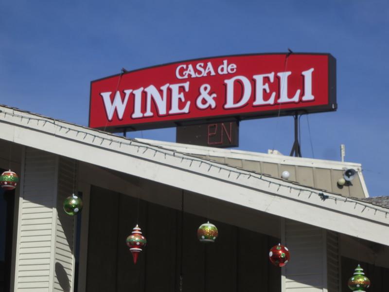 Casa De Wine & Deli sign