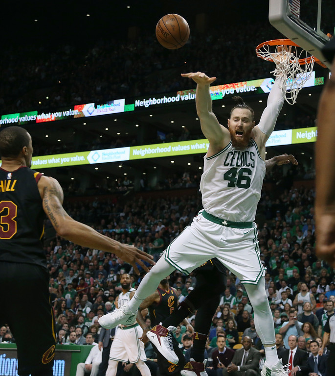 . Boston Celtics center Aron Baynes, right, reaches for a loose ball in front of Cleveland Cavaliers guard George Hill during the second half in Game 7 of the NBA basketball Eastern Conference finals, Sunday, May 27, 2018, in Boston. (AP Photo/Elise Amendola)