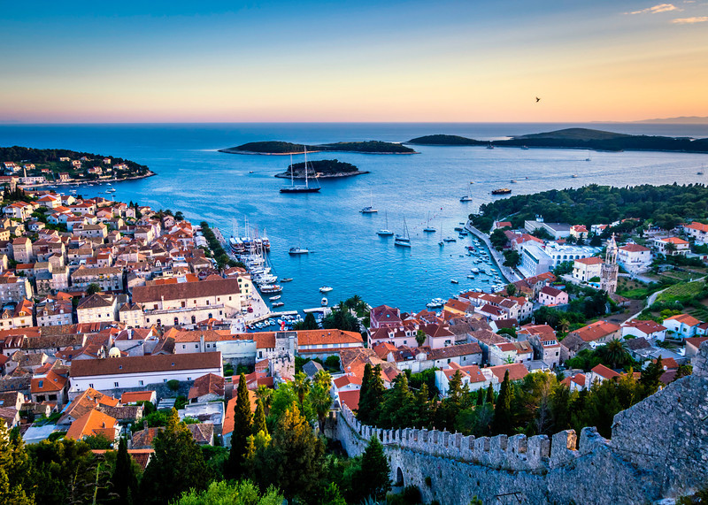 Hvar (Croatian pronunciation: [xv̞âːr]; local Croatian dialect: Hvor or For, Greek: Pharos, Φαρος, Latin: Pharia, Italian: Lesina) is a Croatian island in the Adriatic Sea, located off the Dalmatian coast, lying between the islands of Brač, Vis and Korčula. Approximately 68 km (42.25 mi) long,[1] with a high east-west ridge of Mesozoic limestone and dolomite, the island of Hvar is unusual in the area for having a large fertile coastal plain, and fresh water springs.