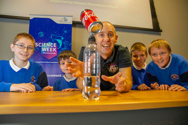 FREE TO USE IMAGE. Pictured during Science Week with WIT (Waterford Institute of Technology) by Calmast with Matt Pritchard, Surprising Science Show at WIT. Pictured with Matt Pritchard are 6th Class Glor Na Mara Tramore students Levi Kelly, Alfie Dunphy, Christopher Taylor, Allan Choptiqny with the Balancing coke can trick. Picture: Patrick Browne