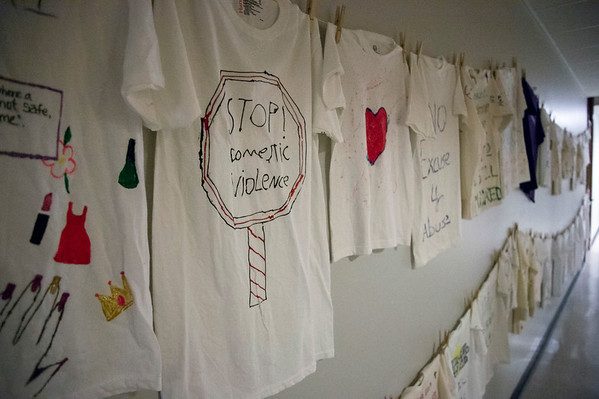 10/02/19 Wesley Bunnell | StaffrrThe Prudence Crandall Center held a candlelight vigil in remembrance of victims of domestic violence on Wednesday night. T-shirts with anti domestic violence messages line the hallway of the shelter.