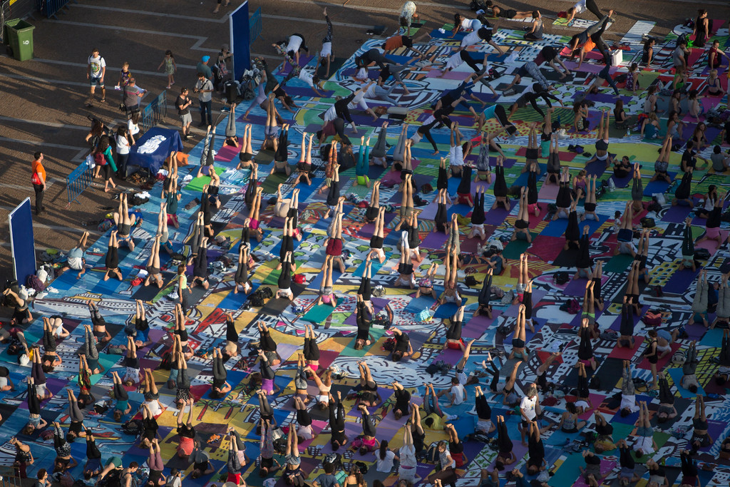 . Israelis practice yoga during the International Yoga Day at the Rabin square in Tel Aviv, Israel, Wednesday, June 21, 2017. (AP Photo/Sebastian Scheiner)