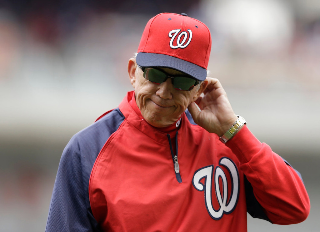 . Washington Nationals manager Davey Johnson walks back to the dougout after pulling starting pitcher Ross Detwiler in the fourth inning of a baseball game against the Colorado Rockies at Nationals Park, Sunday, June 23, 2013, in Washington. (AP Photo/Carolyn Kaster)