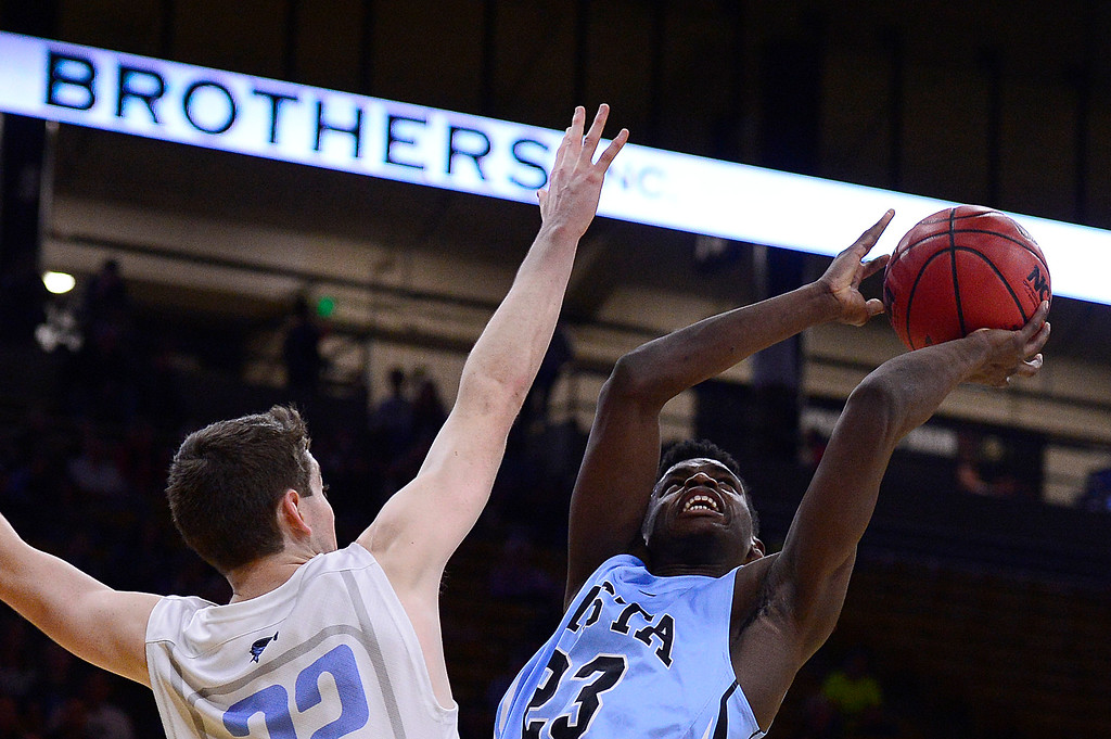 . Breon Michel (23) of Vista Ridge shoots around the arm of Jacob Wilkinson (22) of Pueblo West during the first quarter at the Coors Events Center on March 11, 2016 in Boulder, Colorado. (Photo by Brent Lewis/The Denver Post)