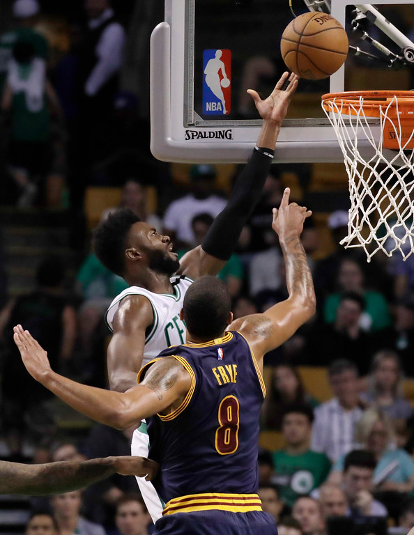 . Boston Celtics forward Jaylen Brown, rear, shoots a layup over Cleveland Cavaliers forward Channing Frye (8) during the second half of Game 2 of the NBA basketball Eastern Conference finals, Friday, May 19, 2017, in Boston. (AP Photo/Elise Amendola)
