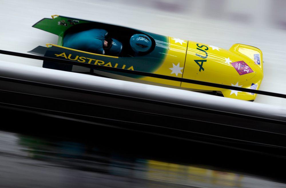 . The team from Australia AUS-1, piloted Astrid Radjenovic with brakeman Jana Pittman, take a curve during the women\'s two-man bobsled competition at the 2014 Winter Olympics, Tuesday, Feb. 18, 2014, in Krasnaya Polyana, Russia. (AP Photo/Michael Sohn)