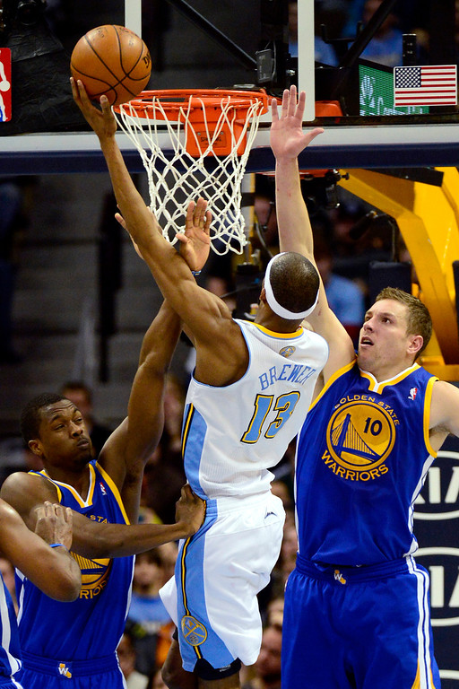 . Denver Nuggets small forward Corey Brewer (13) drives against Golden State Warriors power forward David Lee (10) during the second half of the Nuggets\' 116-105 win at the Pepsi Center on Sunday, January 13, 2013. AAron Ontiveroz, The Denver Post