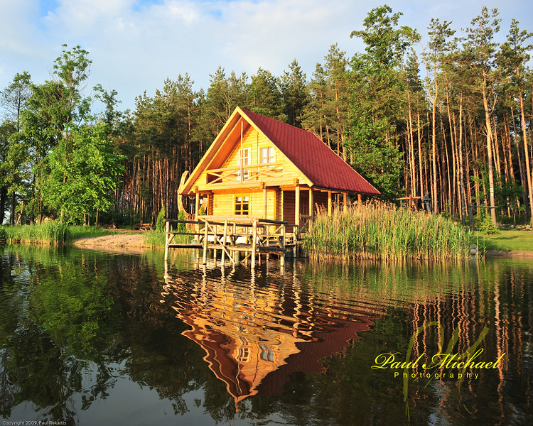 Boat house, bunch of beds upstairs and kitchen downstairs.  No bathroom!  Outhouse in forest.