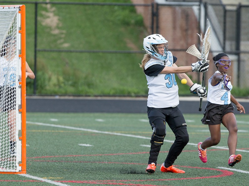 Eleanor Roosevelt Goalie Zosia Nicholson was not able to stop the onslot of Dulaney shots, many from just outside the crease. PHOTO BY MIKE CLARK