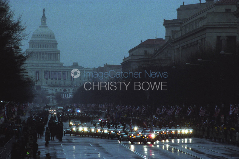 The presidential motorcade leads the Inaugural Parade at George W. Bush's first Inauguration.