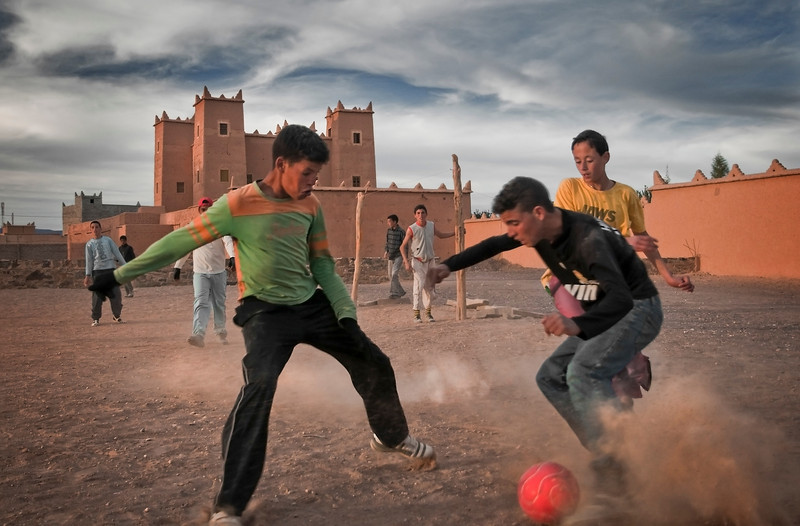 The beautiful game is everywhere in Morocco. here kids play the game overlooked by an ancient Kasbah. N Kob, 