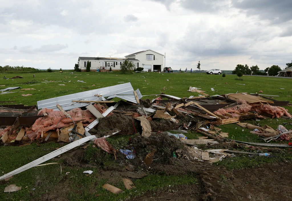 . Debris from Tuesday\'s storm sits along a road on Wednesday, July 9, 2014, in Smithfield, N.Y. (AP Photo/Mike Groll)
