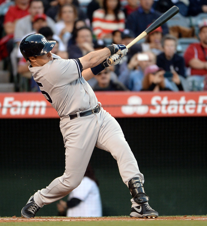 . New York Yankees\' Mark Teixeira watches his two RBI double in the first inning of a baseball game against the Los Angeles Angels at Anaheim Stadium in Anaheim, Calif., on Wednesday, May 7, 2014.  (Keith Birmingham Pasadena Star-News)