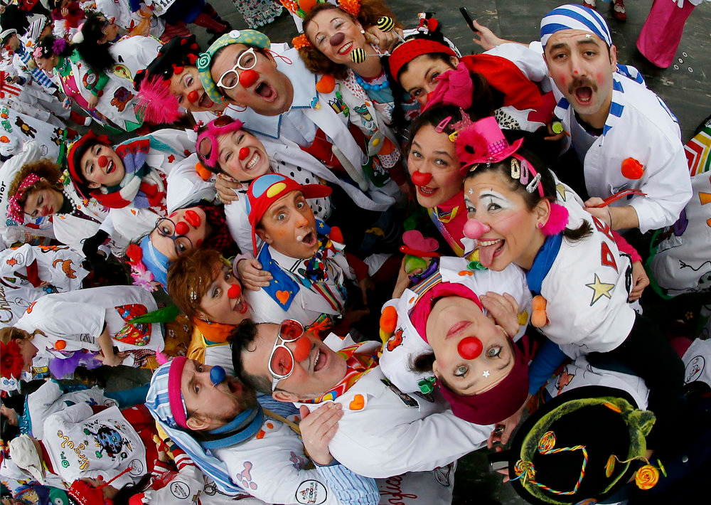 . Some 200 clowns of the foundation Theodora - clowns for our kids in hospital - celebrate their 20th anniversary outside the Swiss parliament building in Bern on January 30, 2013. The Theodora foundation was established in eight countries: Switzerland, France, Spain, Italy, England, Turkey, Hong Kong and Belarus in 1993 to cheer up children in hospital.   REUTERS/Pascal Lauener