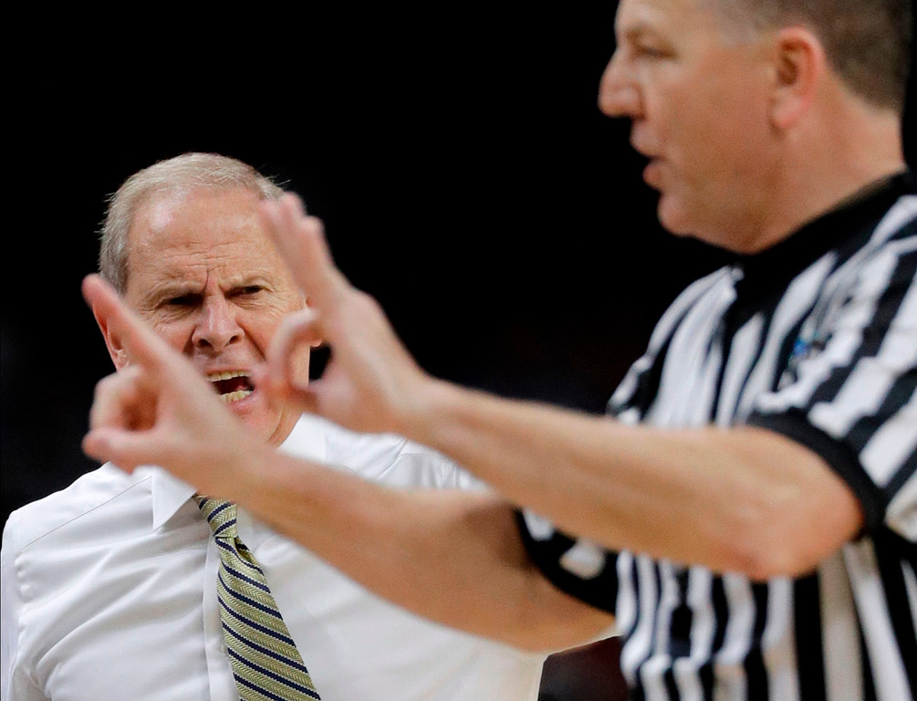 . Michigan head coach John Beilein, left, reacts to a call against his team during the second half against Villanova in the championship game of the Final Four NCAA college basketball tournament, Monday, April 2, 2018, in San Antonio. (AP Photo/David J. Phillip)