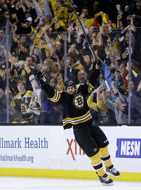 . Boston Bruins defenseman Adam McQuaid  celebrates his goal against the Pittsburgh Penguins during the third period of Game 4 in the Eastern Conference finals of the NHL hockey Stanley Cup playoffs, in Boston on Friday, June 7, 2013. (AP Photo/Elise Amendola)