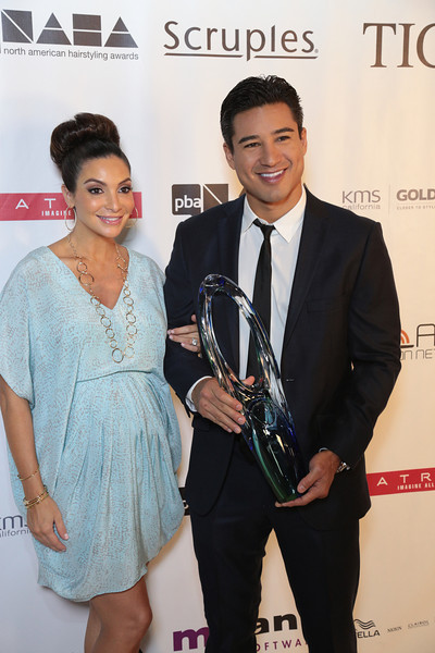 Mario Lopez with the Professional Beauty Association's Beautiful Humanitarian Award and wife Courtney at the 2013 NAHAs