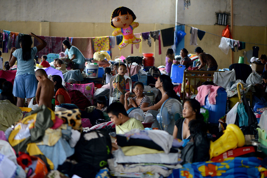 . Flood victims cover the floor of a basketball court-turned-evacuation centre in San Mateo, Rizal, east of Manila on August 22, 2013.  Disaster-weary Philippine residents mopped up on August 22 after four days of torrential rain that officials said had killed 17 people and forced more than half a million from flooded homes. NOEL CELIS/AFP/Getty Images