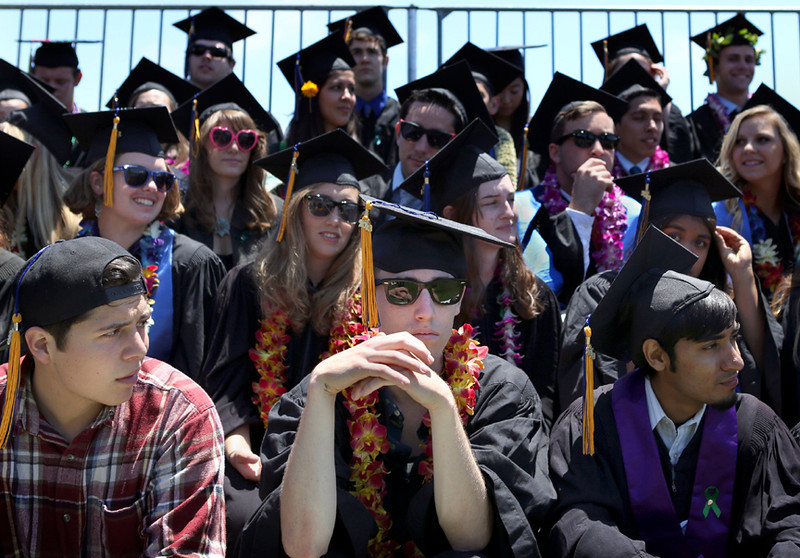 . UCSC students pack the stands at the lower west field at Oaks College on Saturday for the College Eight graduation ceremony. (Kevin Johnson/Sentinel)