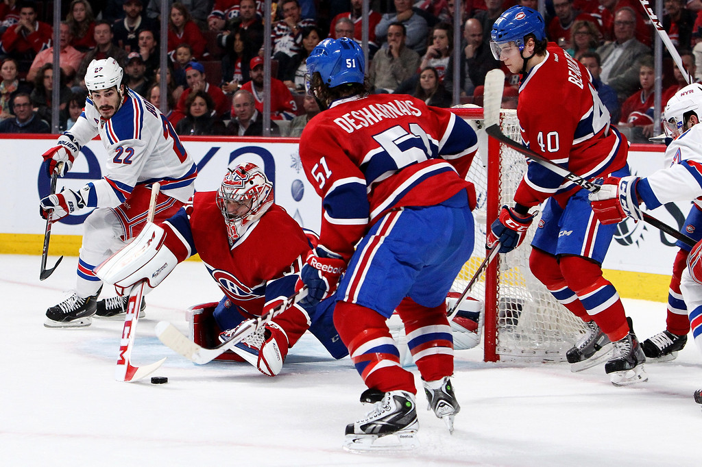 . MONTREAL, QC - MAY 17:  Goaltender Carey Price #31 of the Montreal Canadiens makes a save alongside Brian Boyle #22 of the New York Rangers in the first period in Game One of the Eastern Conference Finals of the 2014 NHL Stanley Cup Playoffs at the Bell Centre on May 17, 2014 in Montreal, Canada.  (Photo by Francois Laplante/Freestyle Photography/Getty Images)