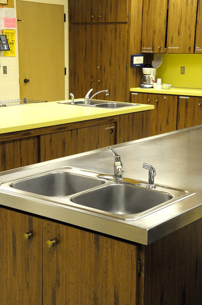 As you walk to the back you will see two sinks across the room that are to be used to scrape clean bowls and plates.