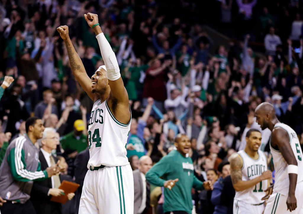 . Boston Celtics forward Paul Pierce (34) reacts to the crowd after they defeated the Denver Nuggets 118-114 in triple overtime in an NBA basketball game in Boston, Sunday, Feb. 10, 2013. (AP Photo/Elise Amendola)