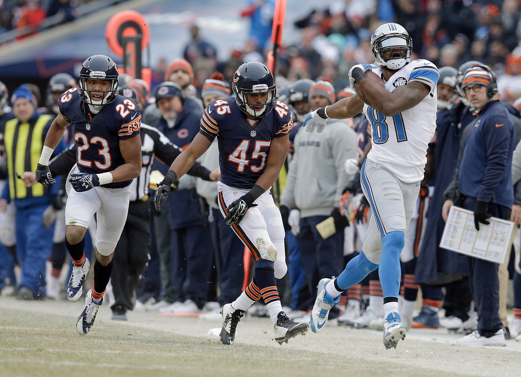. Detroit Lions wide receiver Calvin Johnson (81) tries to stay inside in bounds after Chicago Bears safety Brock Vereen (45) pushed him in the second half of an NFL football game Sunday, Dec. 21, 2014, in Chicago. At left is Bears cornerback Kyle Fuller (23) (AP Photo/Nam Y. Huh)