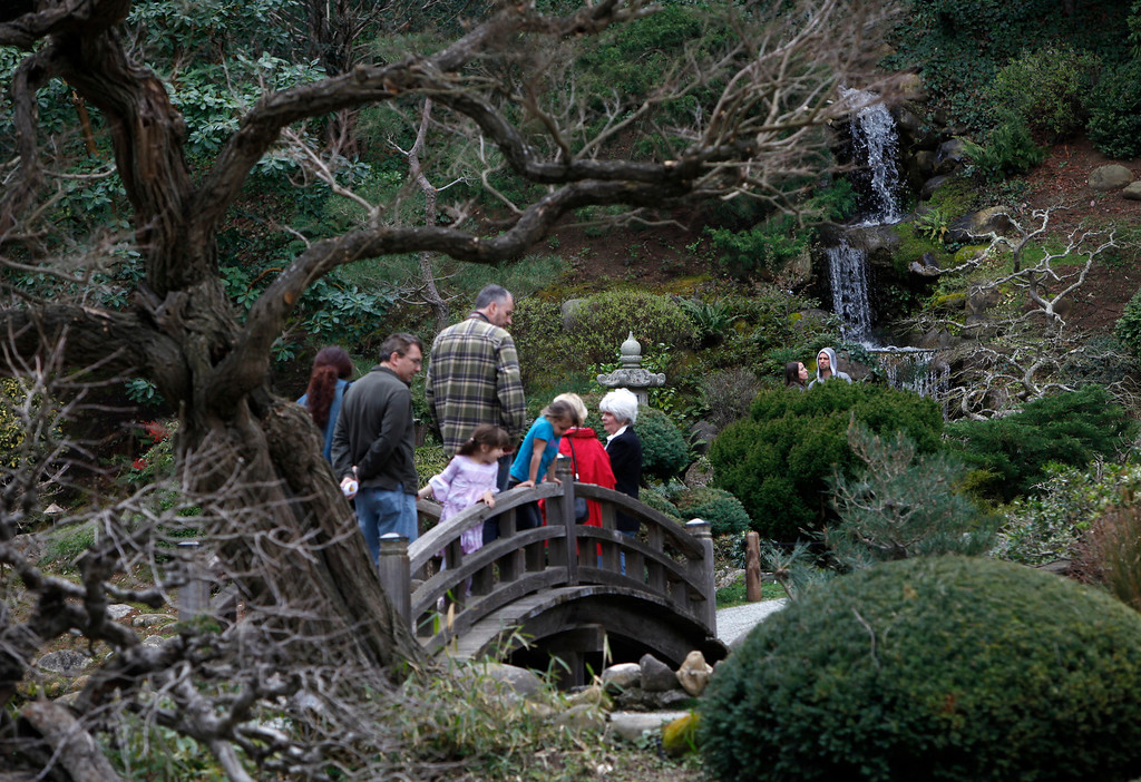 """. Visitors wander through Hakone Estate and Gardens during a Lunar New Year of the Snake festival with a \""""Chinese Village Fair\"""" on Sunday afternoon, March 3, 2013 in Saratoga, Calif. (Karl Mondon/Staff)"""