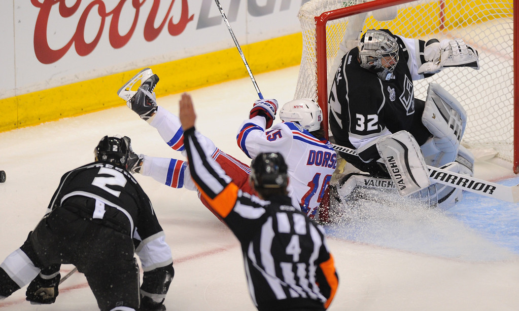 . The Rangers\' Derek Dorsett crashes into the net after being tripped by the Kings\' Matt Greene, left, in the second period of game two of the Stanley Cup Final, Saturday, June 7, 2014, at Staples Center. (Photo by Michael Owen Baker/Los Angeles Daily News)