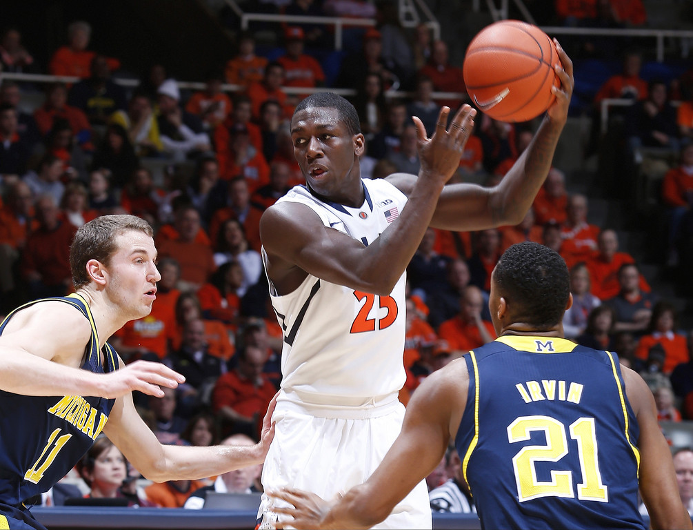 . CHAMPAIGN, IL - MARCH 4:  Kendrick Nunn #25 of the Illinois Fighting Illini handles the ball against Nik Stauskas #11 and Zak Irvin #21 of the Michigan Wolverines during the game at State Farm Center on March 4, 2014 in Champaign, Illinois. Michigan defeated Illinois 84-53. (Photo by Joe Robbins/Getty Images)