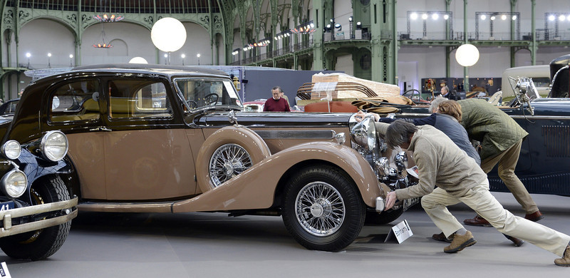 . A Daimler 4 Litre Sports berline (1939) is pictured as luxury vintages cars are displayed at an auction at the Grand Palais on February 6, 2013 in Paris. 125 vintage motor cars, 100 collection motorbikes and a 1920\'s Gipsy Moth plane by De Havilland, will be presented at the Bonhams auction on February 7.  BERTRAND GUAY/AFP/Getty Images