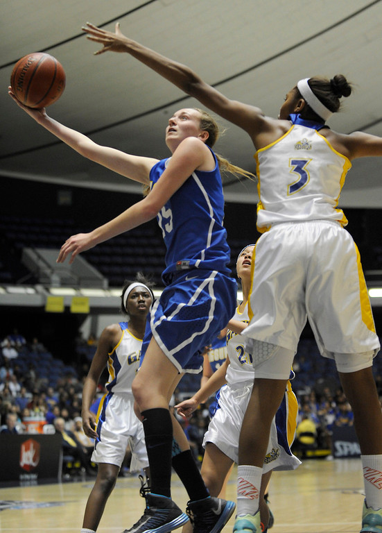 . Agoura #15 Kim Jacobs gets past Gahr #3 Jewelyn Sawyer. Agoura defeated Gahr 60-39 in the CIF-SS Division III-AAA Girls Basketball Championship at the Anaheim Convention Center in Anaheim, CA 2/23/2013(John McCoy/Staff Photographer)