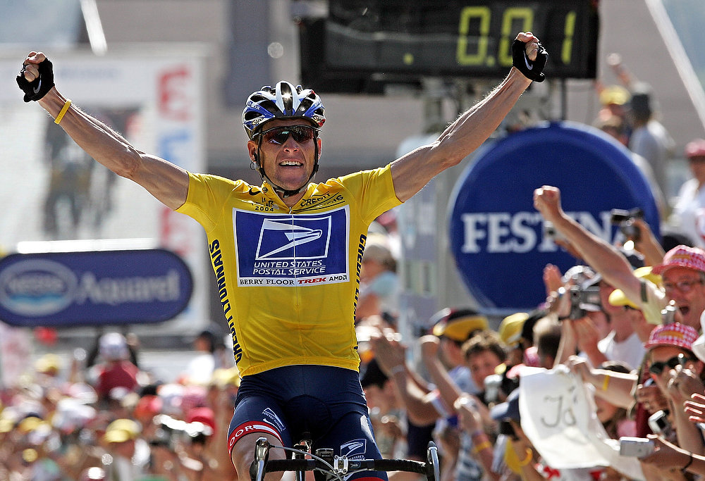 Description of . Lance Armstrong celebrates as he crosses the finish line and wins the 17th stage of the 91st Tour de France cycling race between Bourg-d'Oisans and Le Grand Bornand, on July 22, 2004. Disgraced cyclist Lance Armstrong, who was stripped of his seven Tour de France titles for doping, is weighing whether to admit he used performance-enhancing drugs, The New York Times reported on January 5, 2013. PATRICK KOVARIK/AFP/Getty Images