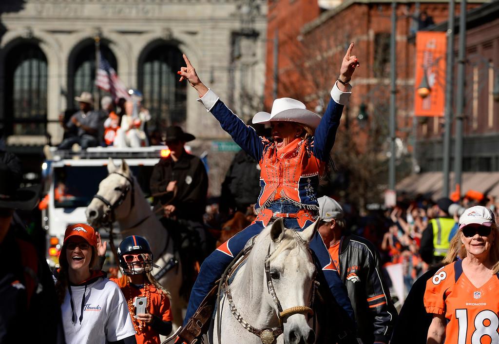 . DENVER, CO - JANUARY 9:  Ann Judge-Wegener rides Thunder the Broncos mascot at the beginning of the Denver Broncos Super Bowl 50 victory parade along 17th street on February 9, 2016 in Denver, Colorado.   (Photo by Helen H. Richardson/The Denver Post)