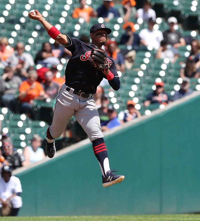 . Cleveland Indians shortstop Francisco Lindor is unable to make a leaping throw to put out Detroit Tigers\' Jose Iglesias at first during the sixth inning of a baseball game, Wednesday, May 16, 2018, in Detroit. (AP Photo/Carlos Osorio)