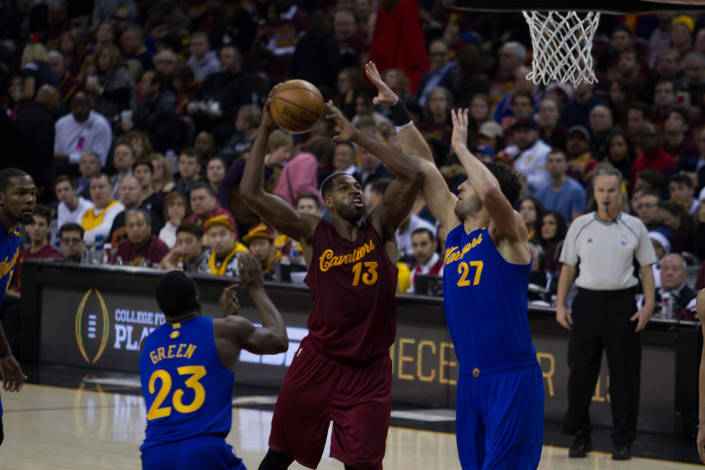 . Tristan Thompson (13) of the Cleveland Cavaliers goes up for the dunk against the Golden State Warriors\' Zaza Pachulia during an NBA game at the Quicken Loans Arena on Christmas day.  The Cavs defeated the Warriors 109-108.  Michael Johnson - The News Herald