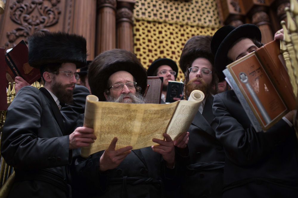 . Ultra-Orthodox Jews read the Book of Esther at a synagogue in Jerusalem on March 16, 2014 during the feast of Purim. The carnival-like Purim holiday is celebrated with parades and costume parties to commemorate the deliverance of the Jewish people from a plot to exterminate them in the ancient Persian empire 2,500 years ago, as recorded in the Biblical Book of Esther. (MENAHEM KAHANA/AFP/Getty Images)