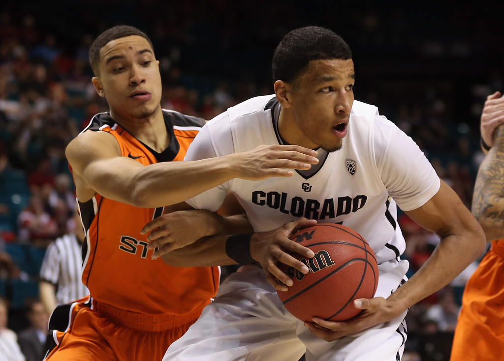 . LAS VEGAS, NV - MARCH 13:  Andre Roberson #21 of the Colorado Buffaloes is defended by Challe Barton #4 of the Oregon State Beavers in the second half during the first round of the Pac 12 Tournament at the MGM Grand Garden Arena on March 13, 2013 in Las Vegas, Nevada. Colorado defeated Oregon State 74-68.  (Photo by Jeff Gross/Getty Images)