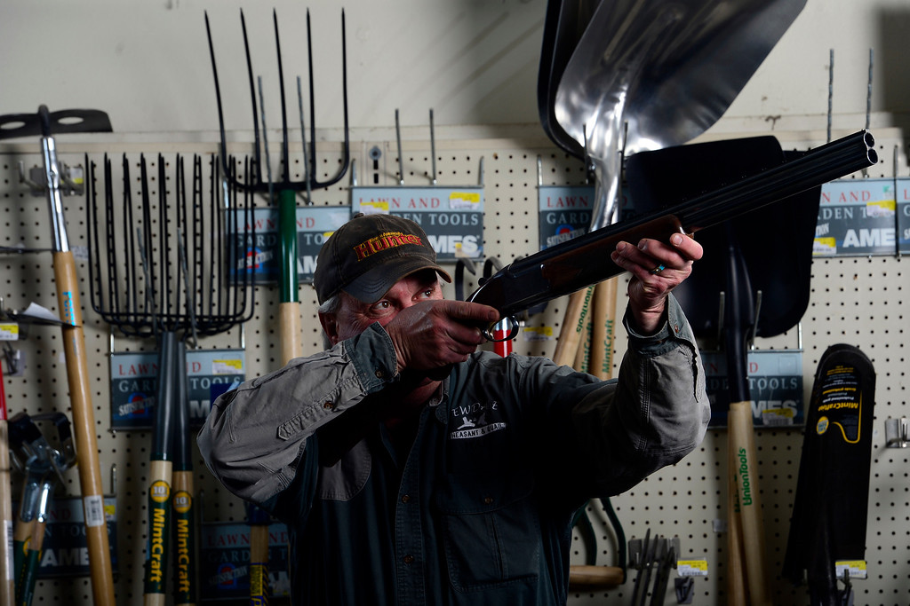 . ROCKY FORD, CO - FEBRUARY 25: Hal Holder shows off his .12 gauge shotgun at his store, Arkansas Valley Lumber and Supply. Gun owners in southern Colorado largely agree that responsible ownership begins at home. (Photo by AAron Ontiveroz/The Denver Post)