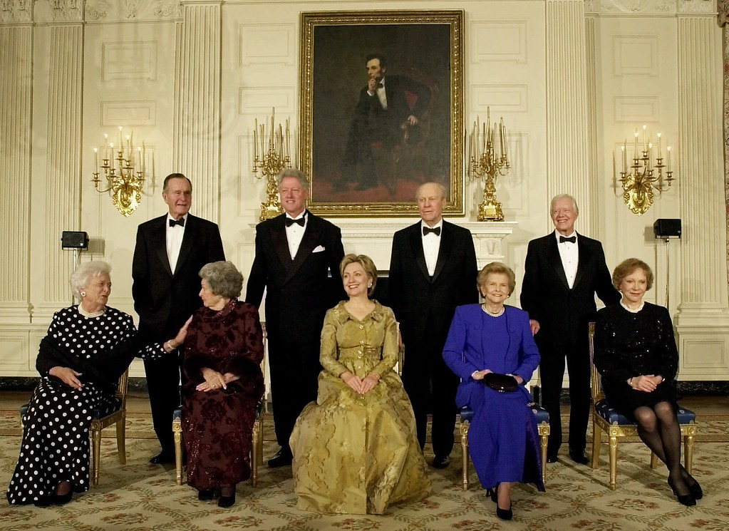 . President Clinton, standing, second from left, and first lady Hillary Rodham Clinton, seated center, pose with former first lady Lady Bird Johnson, seated second left, former President George Bush and former first lady Barbara Bush, far left, former President Gerald R. Ford and former first lady Betty Ford, second from right, and former President Jimmy Carter and former first lady Rosalynn Carter, far right, during a dinner in honor of the 200th Anniversary of the White House Thursday, Nov. 9, 2000 in Washington. (AP Photo/Kenneth Lambert)