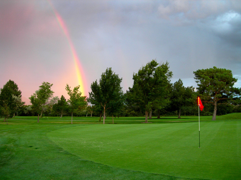 2012-8-22 ––– A fun evening of golf. I was worried I wouldn't get all 18 holes in because it was raining all around me. Fortunately it never hit the golf course. But there were several spectacular rainbows as the rain fell and the sun set. Luckily I had a camera with me.