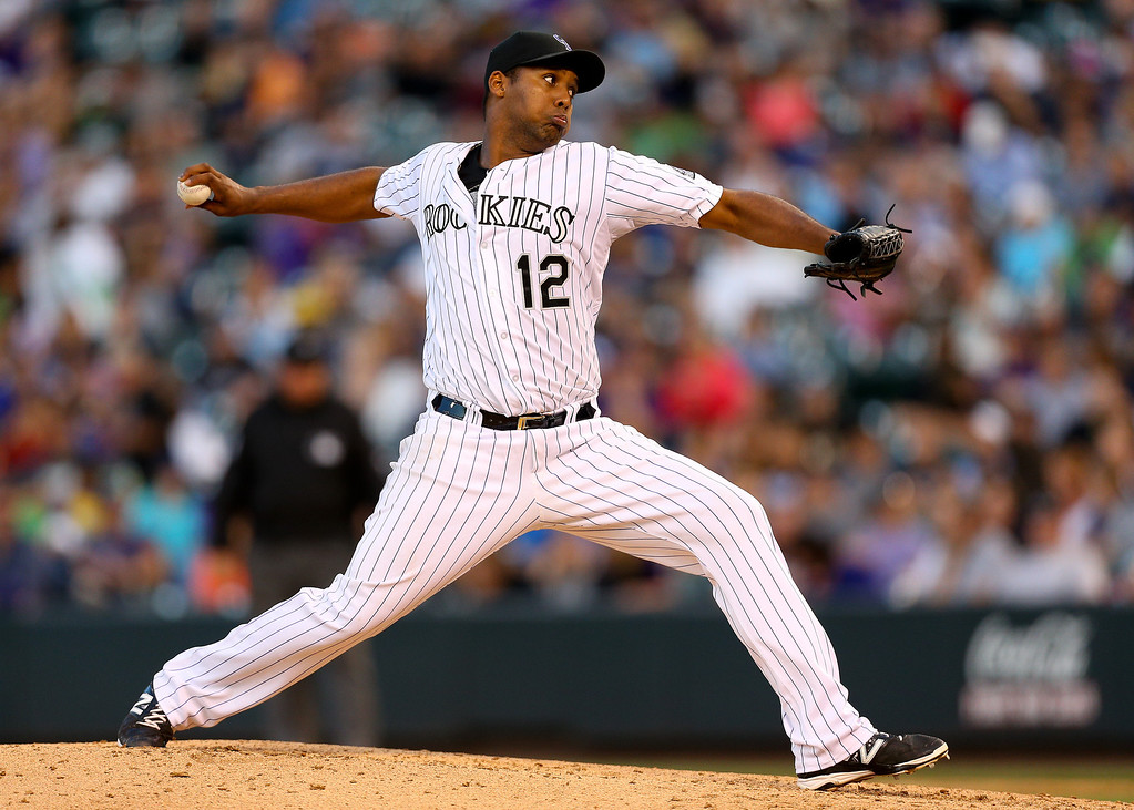 . Starting pitcher Juan Nicasio #12 of the Colorado Rockies delivers to home plate during the fifth inning against the Arizona Diamondbacks at Coors Field on June 5, 2014 in Denver, Colorado.  (Photo by Justin Edmonds/Getty Images)